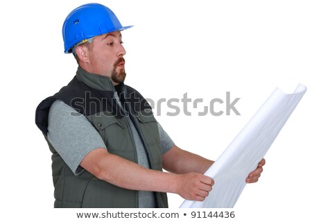Surprised tradesman looking at a blueprint Stock photo © photography33