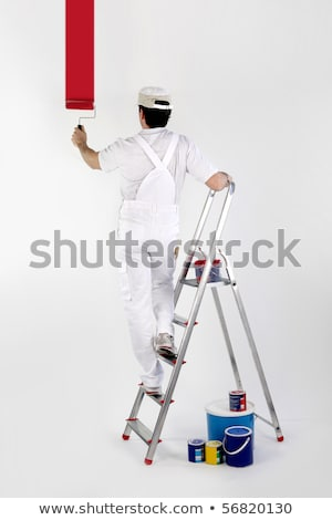 man painting red wall with roller brush stock photo © photography33