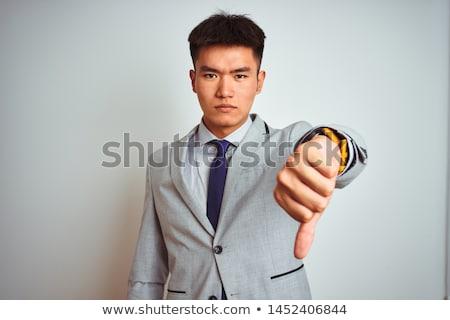 üzletember · hüvelykujjak · lefelé · felirat · kéz · férfiak - stock fotó © ambro