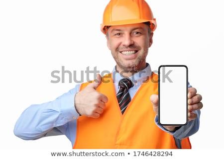 Man showing screen of smartphone, focus on guy Stock photo © adamr