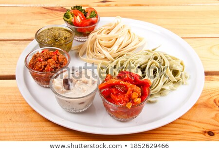 two italian tagliatelles and five various condiments stock photo © ozaiachin