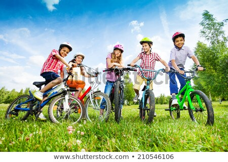 Friends sitting in a field Stock photo © photography33