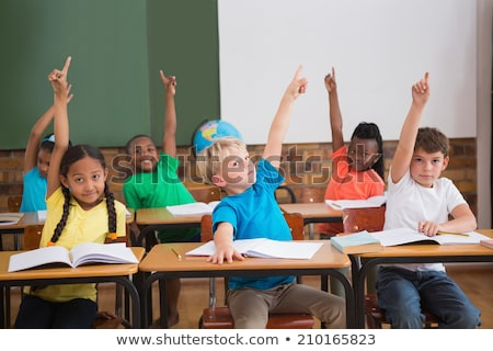 Three pupils in class with arms raised Stock photo © photography33