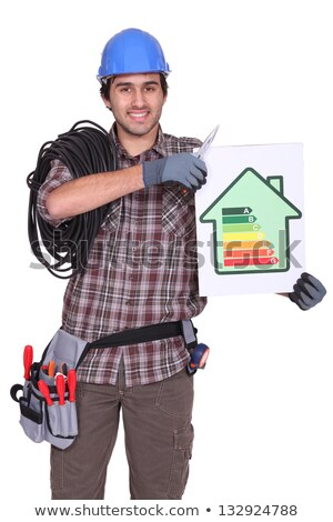 Elektriker halten Energie Verbrauch Label Haus Stock foto © photography33