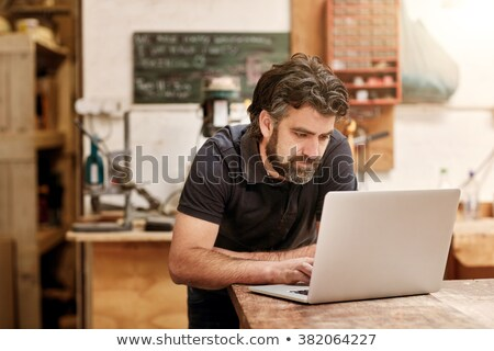 mature craftsman working on his laptop stock photo © photography33