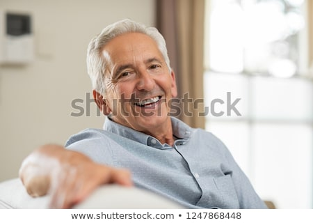 sitting man is smiling stock photo © feedough