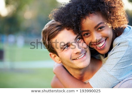 Mixed-race couple at the park Stock photo © photography33