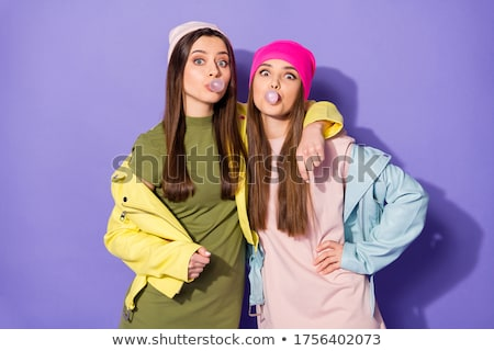 Two cheerful girls blow bubbles. Isolated Stock photo © acidgrey
