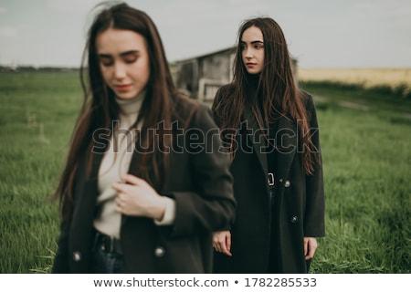 Kettő fiatal nők ül padló megérint egyéb Stock fotó © courtyardpix