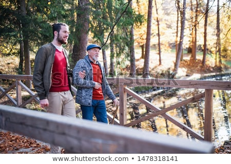 father with son on autumn bridge stock photo © Paha_L