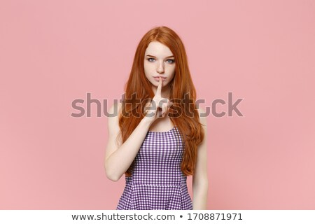 çekici · genç · kadın · sessizlik · jest · kırmızı · elbise - stok fotoğraf © dolgachov