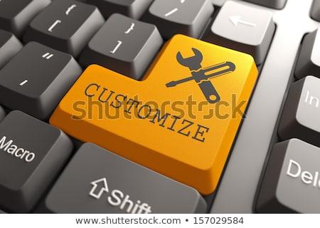 Keyboard with Customize Orange Button. Stock photo © tashatuvango
