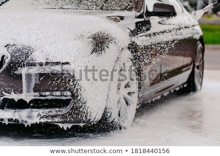 Stock photo: car and pressure washer