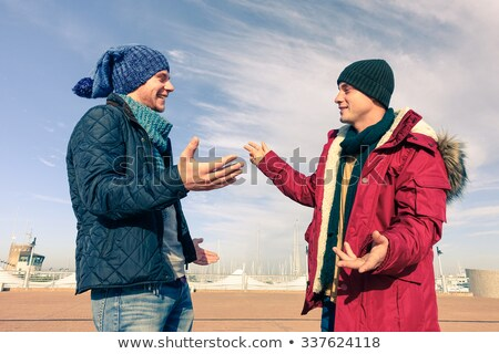 smiling casual man in winter clothes and furry hat Stock photo © feedough