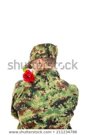 солдата назад красную розу плечо романтические Сток-фото © feelphotoart