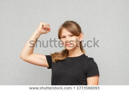 nő · sportruha · pózol · mutat · izmok · sport - stock fotó © hasloo