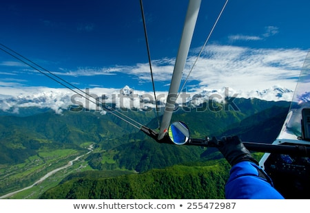 Sky gliding in mountains Stock photo © BSANI
