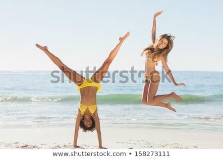 gorgeous blonde in floral bikini posing at the beach stock photo © wavebreak_media