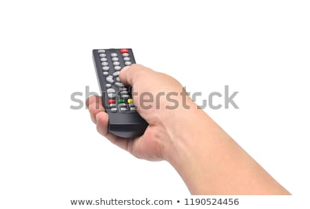 Hand holding remote and changing channel Stock photo © wavebreak_media