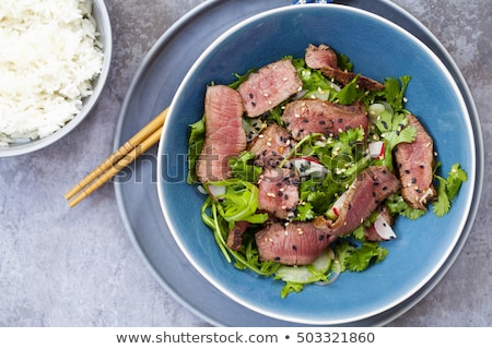 Dish of roast beef with rice and salad leaves Stock photo © vlad_star