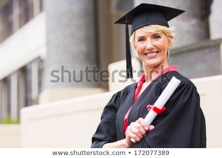 Glimlachend aantrekkelijk vrouw afgestudeerde boord Stockfoto © ozgur