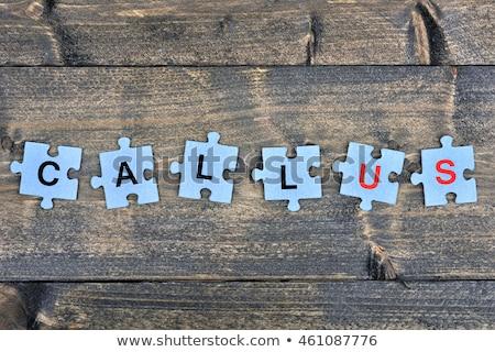 Quebra-cabeça palavra chamar peças do puzzle telefone construção Foto stock © fuzzbones0