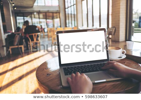 Back view of woman sitting at the table in cafe Stock photo © deandrobot