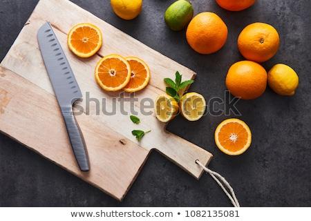 Fresh lemon slices on a cutting board stock photo © Yatsenko
