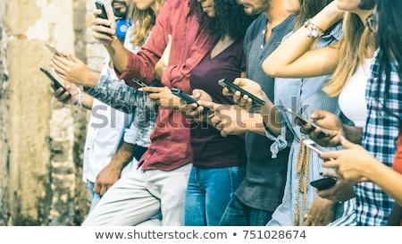 Közösségi háló szenvedélybeteg okostelefon kint park posta Stock fotó © stevanovicigor