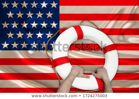 Hand holding a visa against American flag Stock photo © wavebreak_media