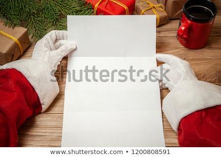 Foto stock: Papai · noel · vermelho · papel · mãos · tabela