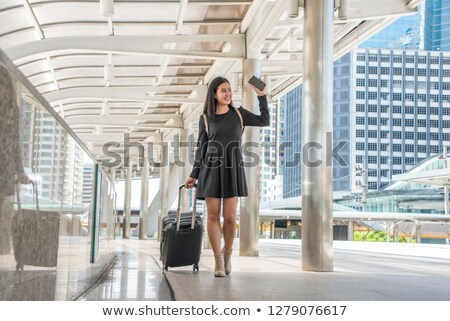 Woman at airport dragging suitcase Stock photo © IS2