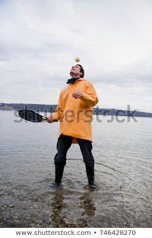 Uomo impermeabile palla gioia piedi Foto d'archivio © IS2