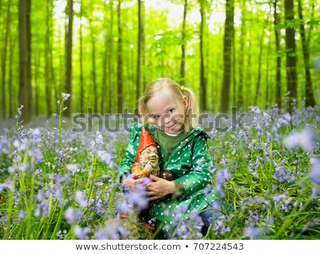 girl with a garden gnome in the woods stock photo © is2