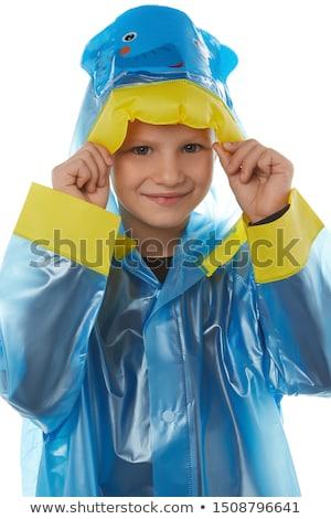 Grappig meisje regenjas hoofd permanente Stockfoto © deandrobot
