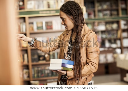 Woman choosing a book Stock photo © IS2