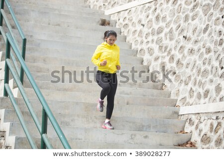 Woman climbing down the stairs Stock photo © IS2