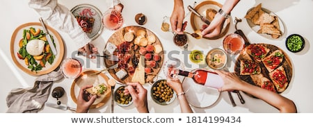 White and rose wine glasses with olives and tomatoes Stock photo © karandaev