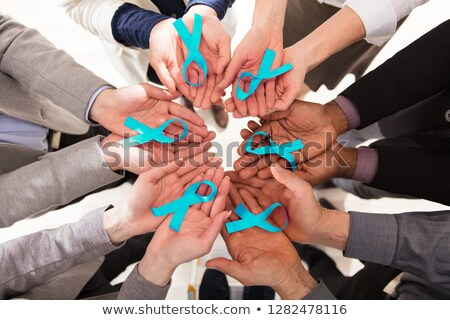 Group Of Businesspeople Holding Teal Ribbons Stock photo © AndreyPopov