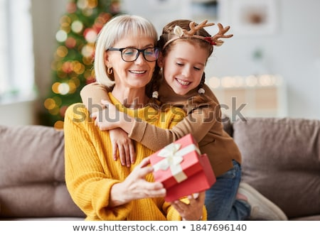 christmas holidays children opening presents stock photo © robuart