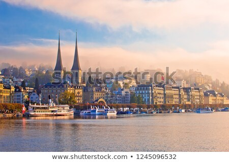Town of Luzern morning fog view from lake Stock photo © xbrchx