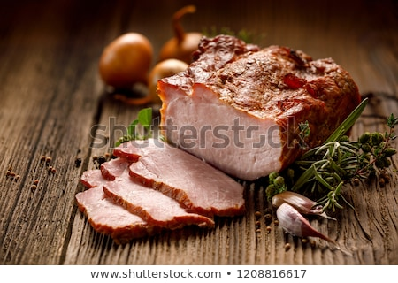 Stock photo: The cut  a smoked pork on a wooden table