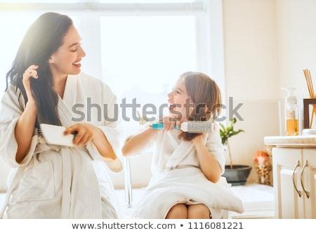 mooie · jonge · vrouw · haren · gezicht · vrouwen · gelukkig - stockfoto © choreograph
