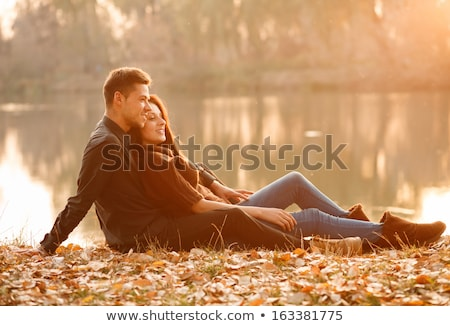 Couple outdoors by lake having good time Stock photo © Lopolo