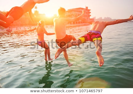 Female leisurely floating in a rock pool by the ocean Stock photo © lovleah