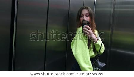 若い女の子 エレベーター 美しい スマートフォン 実例 女性 ストックフォト © jossdiim