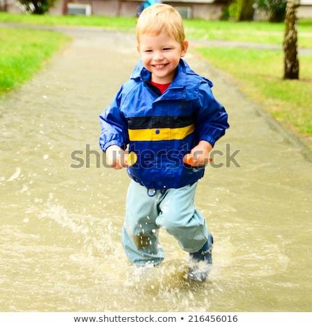 Kicsi fiú pocsolya nyár szabadtér víz Stock fotó © galitskaya