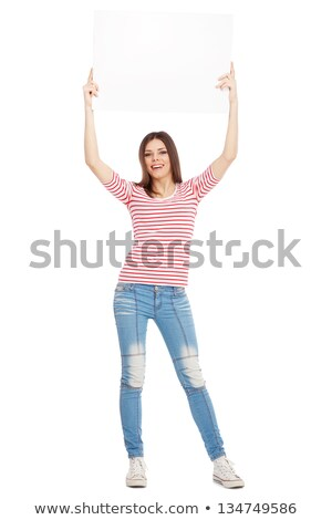 happy red haired teenage girl holding empty hands stock photo © dolgachov