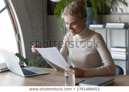 Empresária olhando laptop negócio Foto stock © AndreyPopov