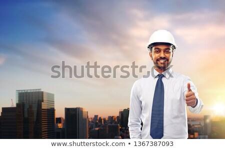indian architect or businessman in helmet in tokyo Stock photo © dolgachov